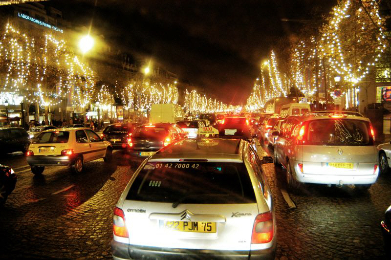 driving into Paris, City of Lights